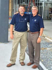 Ed (right) with his brother and IT Manager Curt (left), in front of current major reconstruction of dealership.