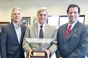 Stillman recognized for 50 years with Volvo: Ed (center) with cousin and Vice President Jerry Wisneski (left), and President and CEO of Volvo Cars N.A. Tony Nicolosi (right).
